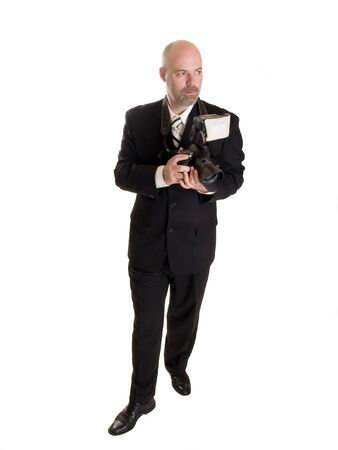 Stock photo of a well dressed wedding photographer.  Full length, isolated on white. photo