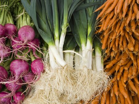 beets: Beets, Carrots, and Leaks - Organic produce on display at the Farmers Market. Stock Photo