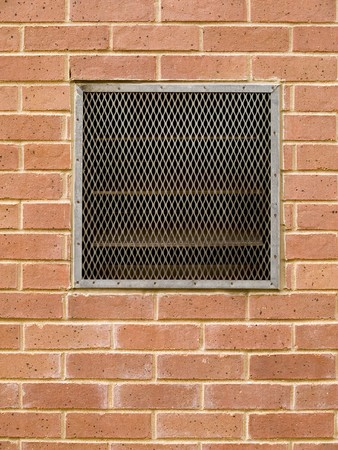 Stock macro photo of a grate over an air vent set into a brick wall.  Stock Photo - 8051127