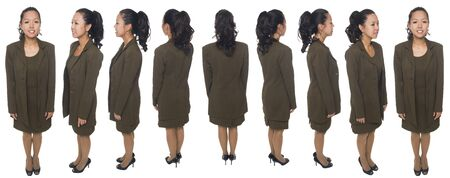 rotation: Isolated full length studio shot of a businesswoman rotating 360 degrees. Stock Photo
