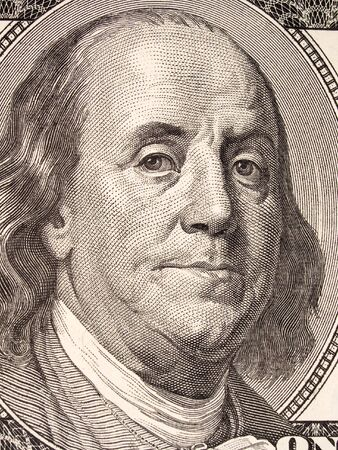 monies: Stock macro photo of a United States one hundred dollar bill, featuring Benjamin Franklin and Independence Hall.