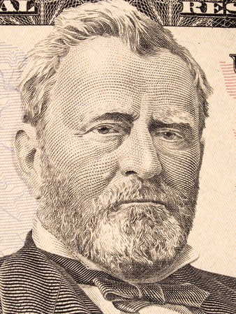 50: Stock macro photo of a United States fifty dollar bill, featuring Ulysses S. Grant and the United States Capitol building.