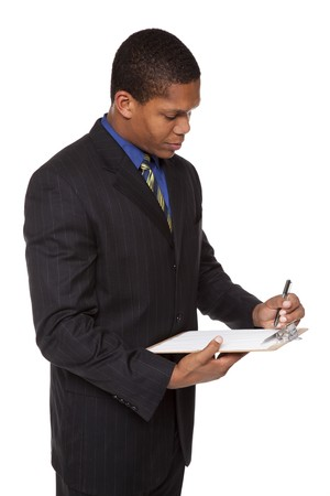 Isolated studio shot of a businessman filling out a questionnaire on a clipboard. photo