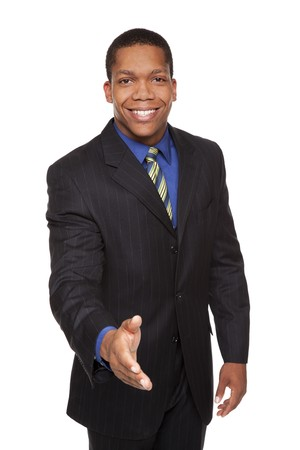 Isolated studio shot of a businessman reaching out to shake hands. photo