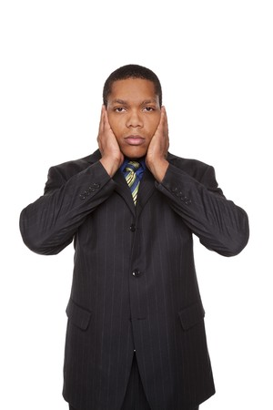 Isolated studio shot of a businessman in the Hear No Evil pose. photo