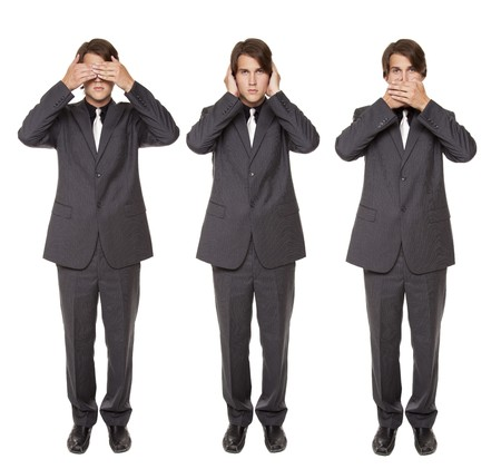 Isolated studio shot of a businessman in the See No Evil, Hear No Evil, Speak No Evil poses.
