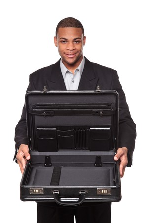contained: Isolated studio shot of a smiling African American businessman holding an open briefcase as if it contained something valuable.  Stock Photo
