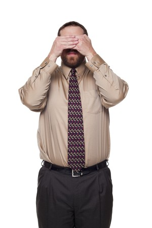 Isolated studio shot of a Caucasian businessman in the See No Evil pose. photo