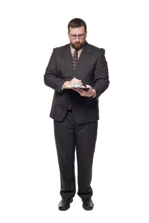 Isolated full length studio shot of the front view of a businessman writing on a clipboard. photo