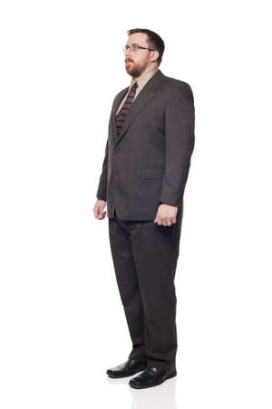 Isolated full length studio shot of the front view of a businessman in full suit looking away from the camera. photo