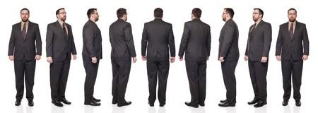 Coup de studio isolé de pleine longueur de la rotation d'un homme d'affaires en costume complet à travers 360 degrés. Banque d'images