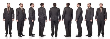 Isolated full length studio shot of the rotation of a businessman in full suit through 360 degrees. photo