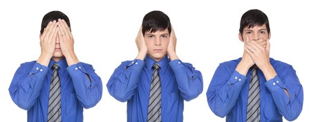 Isolated studio shot of a Caucasian businessman in the See No Evil, Hear No Evil, Speak No Evil poses. photo