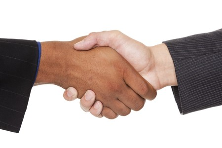 business attire: Isolated closeup studio shot of two businessmen shaking hands