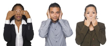 Isolated studio shot of businesspeople in the See No Evil, Hear No Evil, Speak No Evil poses. Stock Photo