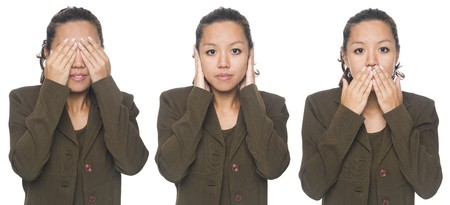 Isolated studio shot of a businesswoman in the See No Evil, Hear No Evil, Speak No Evil poses. photo