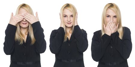 Isolated studio shot of a businesswoman in the speak no evil pose. photo