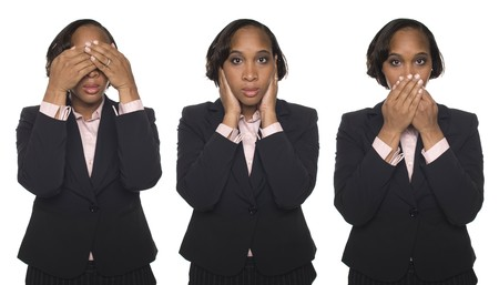 Isolated studio shot of a businesswoman in the See No Evil, Hear No Evil, Speak No Evil poses. Stock Photo - 8051153