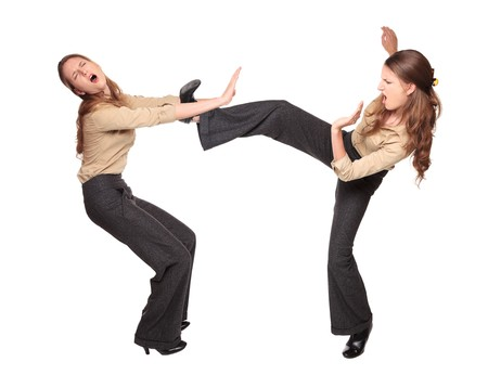 dgf22: Isolated studio shot of a Caucasian businesswoman fighting with herself. Stock Photo