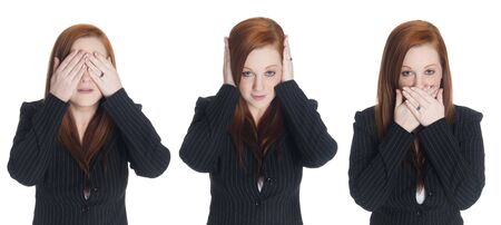 Isolated studio shot of a businesswoman in the See No Evil, Hear No Evil, Speak No Evil pose. Stock Photo - 8052935