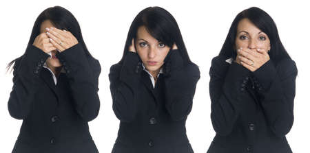 Isolated studio shot of a businesswoman in the See No Evil, Hear No Evil, Speak No Evil pose. photo