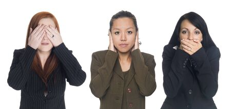 Isolated studio shot of businesswomen in the See No Evil, Hear No Evil, Speak No Evil poses. photo