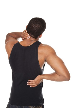 epaule douleur: Isolated studio shot of a muscular man in a fitness outfit experiencing neck, shoulder  and back pain.