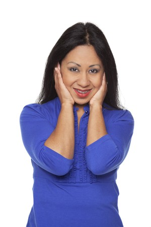 Isolated studio shot of a Latina woman in the Hear No Evil pose. photo