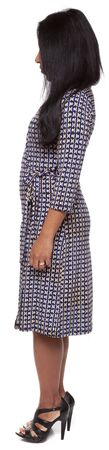 facing away: Isolated full length studio shot of the front view of a Latina woman in a dress facing left (part of a 360 rotational series) Stock Photo