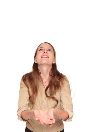 dgf22: Isolated studio shot of a Caucasian businesswoman smiling as she happily looks up while holding out her cupped hands. Stock Photo