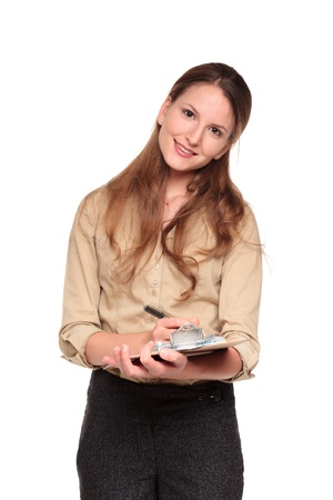dgf22: Isolated studio shot of a smiling Caucasian businesswoman taking notes on a clipboard