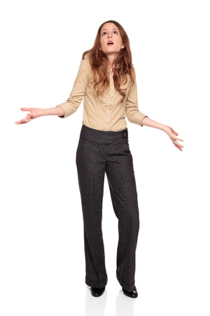 Isolated full length studio shot of the front view of a Caucasian businesswoman looking up in disbelief with arms raised. Stock Photo
