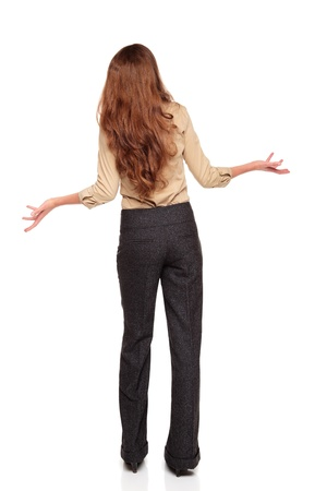 dgf22: Isolated full length studio shot of the rear view of a Caucasian businesswoman looking up in disbelief with arms raised.
