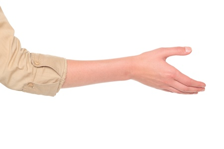 Isolated studio shot of a Caucasian businesswoman reaching out for a handshake.