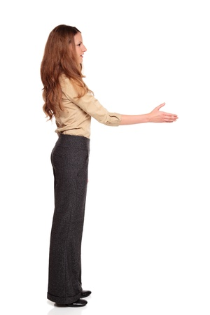 facing away: Isolated full length studio shot of a Caucasian businesswoman reaching out for a handshake. Stock Photo