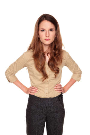 Isolated studio shot of a Caucasian businesswoman with a neutral expression looking at the camera. Stock Photo