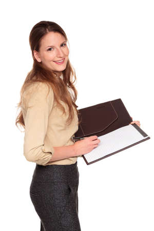 dgf22: Isolated studio shot of a Caucasian businesswoman smiling at the camera while writing on a business notepad. Stock Photo