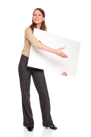 Isolated studio shot of a Caucasian businesswoman holding a large blank sign and reaching out to shake hands as if she were giving away a novelty prize check.  Stock Photo