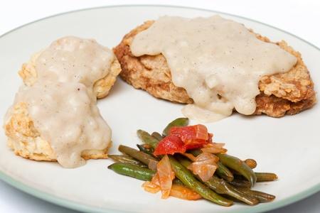 biscuts: Homestyle Vegetarian Chicken Fried Steak, Cream Gravy, Biscuits, and Stewed Tomatoes.