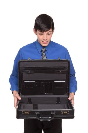 Isolated studio shot of a Caucasian businessman holding out an open empty briefcase. photo