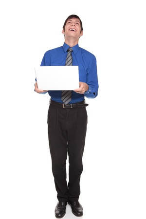 Isolated studio shot of a Caucasian businessman tilting his head back and laughing at what he sees on his computer. photo