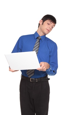 Isolated studio shot of a Caucasian businessman turning his head away and peeking back at his computer screen. photo