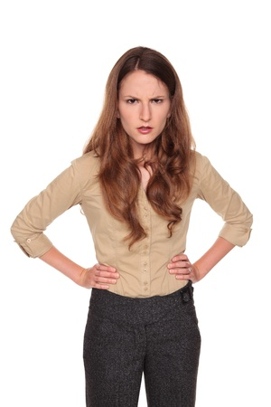 Isolated studio shot of a Caucasian businesswoman making an angry, upset expression with frown.