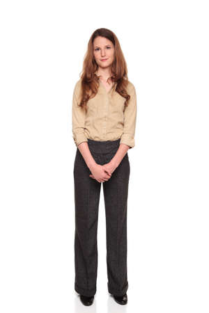 dgf22: Isolated full length studio shot of a Caucasian businesswoman smiling and looking at the camera with her hands clasped in front of her.