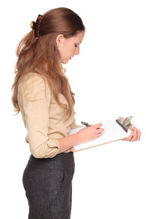 Isolated studio shot of a Caucasian businesswoman taking notes on a clipboard Stock Photo - 9032799