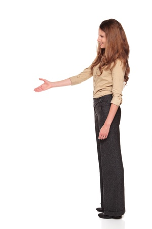 Isolated full length studio shot of a Caucasian businesswoman reaching out for a handshake. Imagens