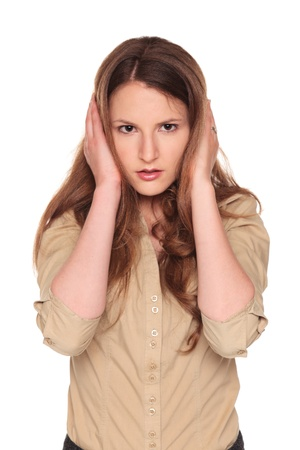 Isolated studio shot of a Caucasian businesswoman in the Hear No Evil pose. Stock Photo