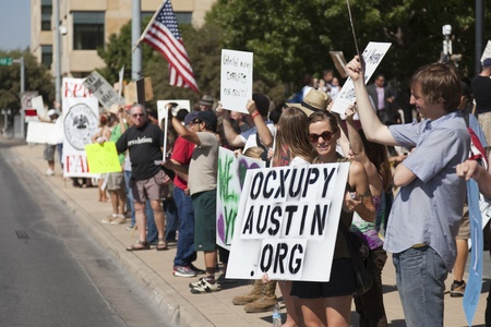 AUSTIN, TX - OCTOBER 15:  An unidentified woman greets traffic during the Occupy Austin general assembly in preparation for the march to the Texas State Capitol on October 15th, 2011 in Austin. Editorial