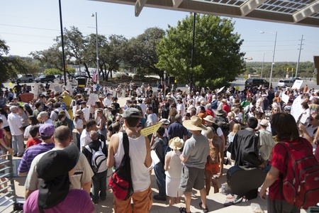 protestors: AUSTIN, TX - OCTOBER 15: A crowd of unidentified protestors gather at the Occupy Austin general assembly in preparation for the march to the Texas State Capitol on October 15th, 2011 in Austin.