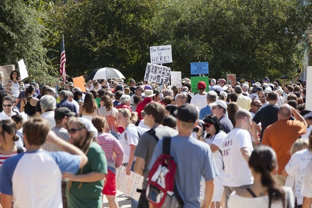 nonviolent: AUSTIN, TX - OCTOBER 15: A crowd of unidentified protestors gather at the Occupy Austin general assembly in preparation for the march to the Texas State Capitol on October 15th, 2011 in Austin.
